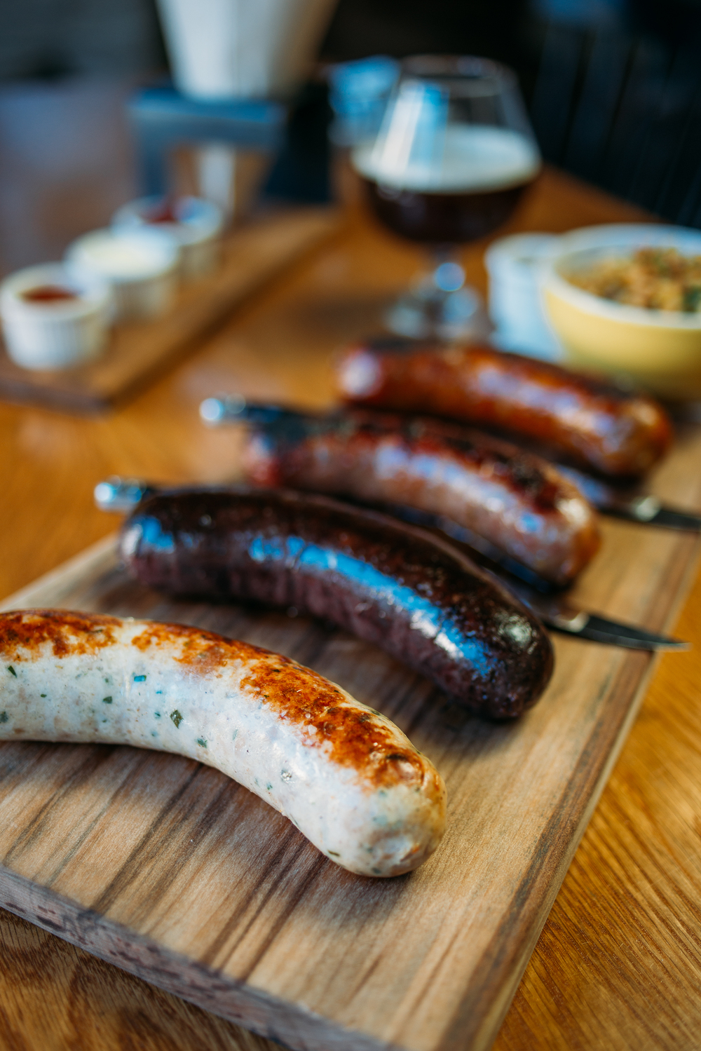 House-made Sausages: Currywurst, Chicken sausage, Cherry-duck sausage
