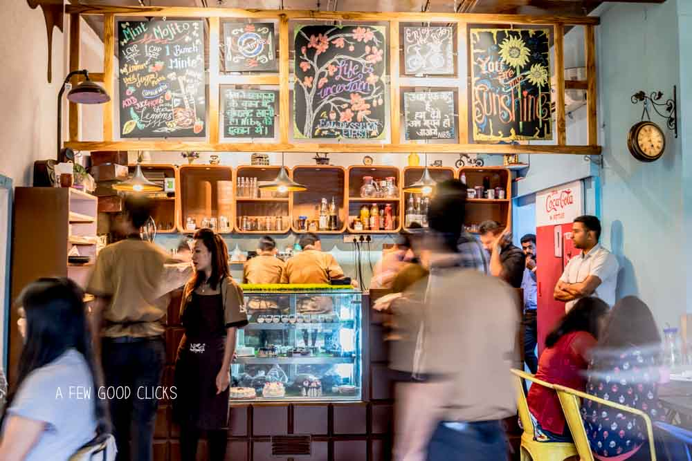 The hustle - bustle at Nibs Coffee Lounge / Image by  California based food photographer  A Few Good Clicks