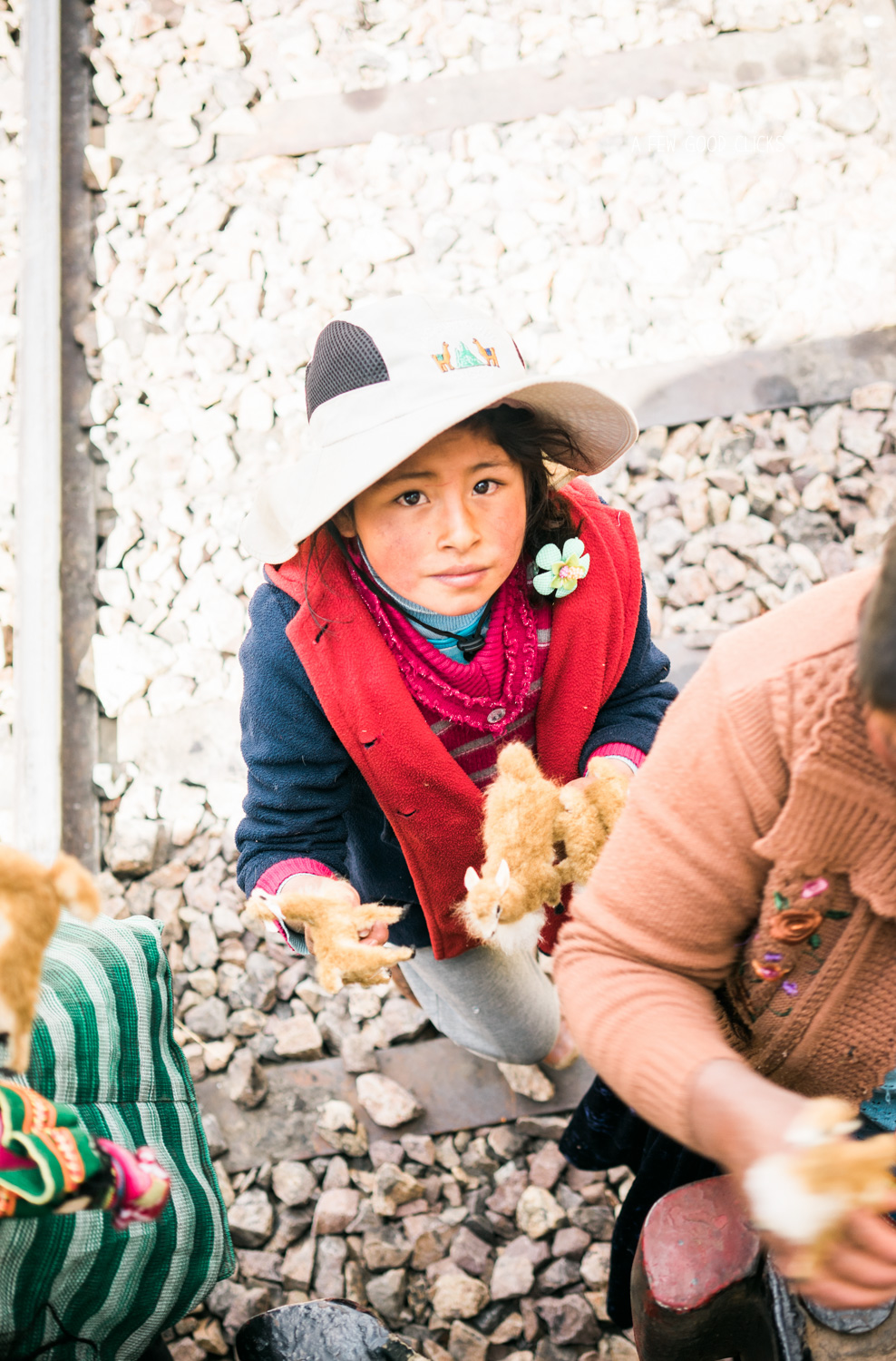 local-tribe-kid-selling-souvenirs-to-tourist-andean-explorer-puno
