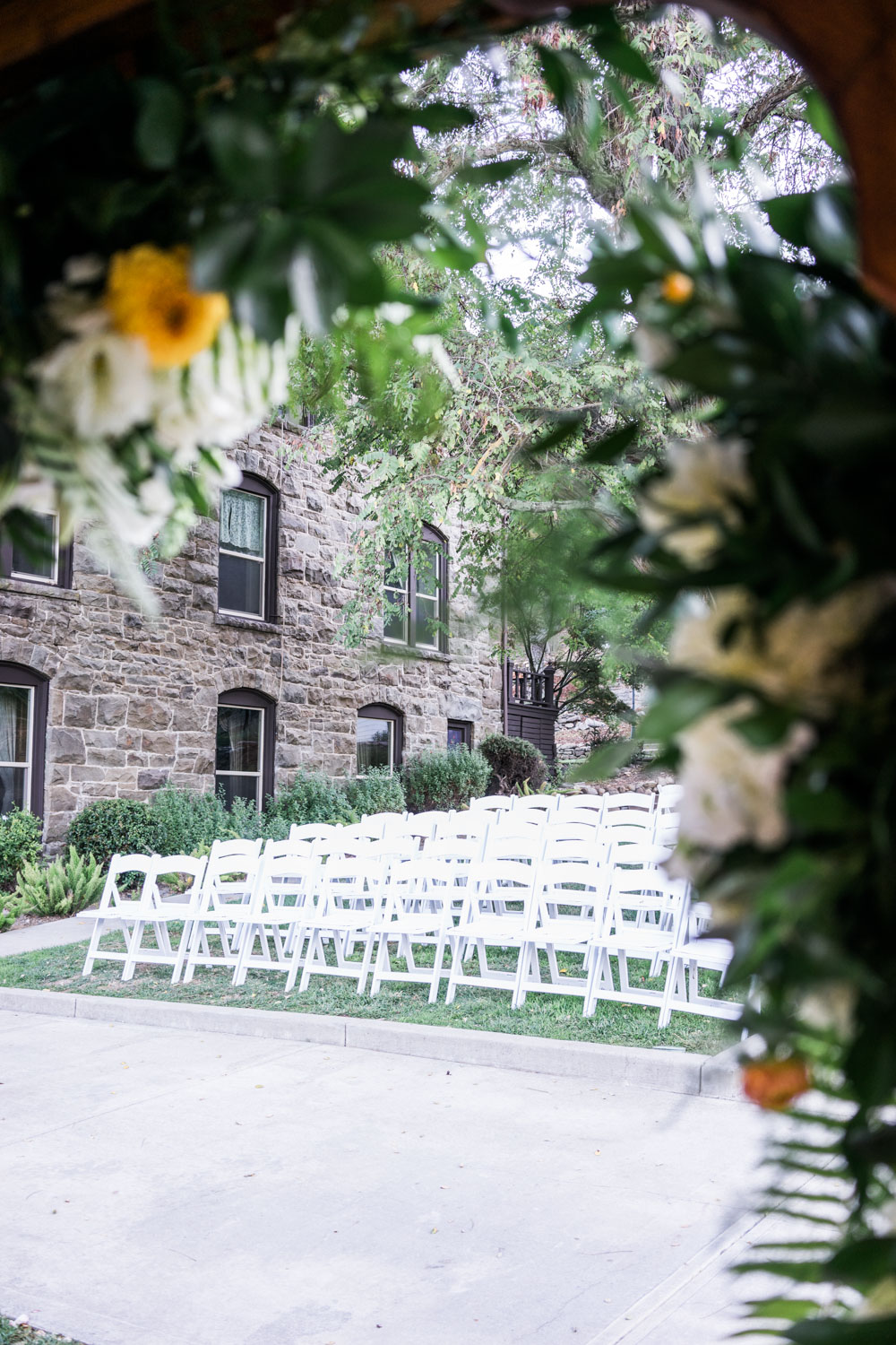 Seating arrangement using white chairs for the guests attending the wedding at Elliston Vineyard, Sunol, CA.