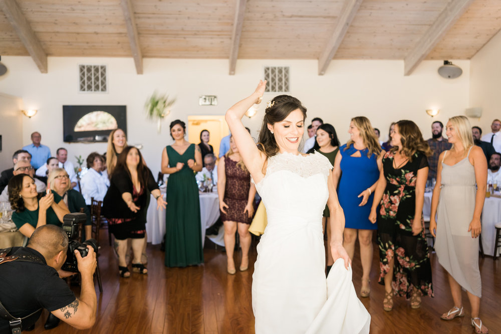 And her best friend caught it. Note to self: Talk to the bride and get the bouquet toss in an open space to capture the action from above. My lead photographer kenny on the left in the photo....can you spot him?
