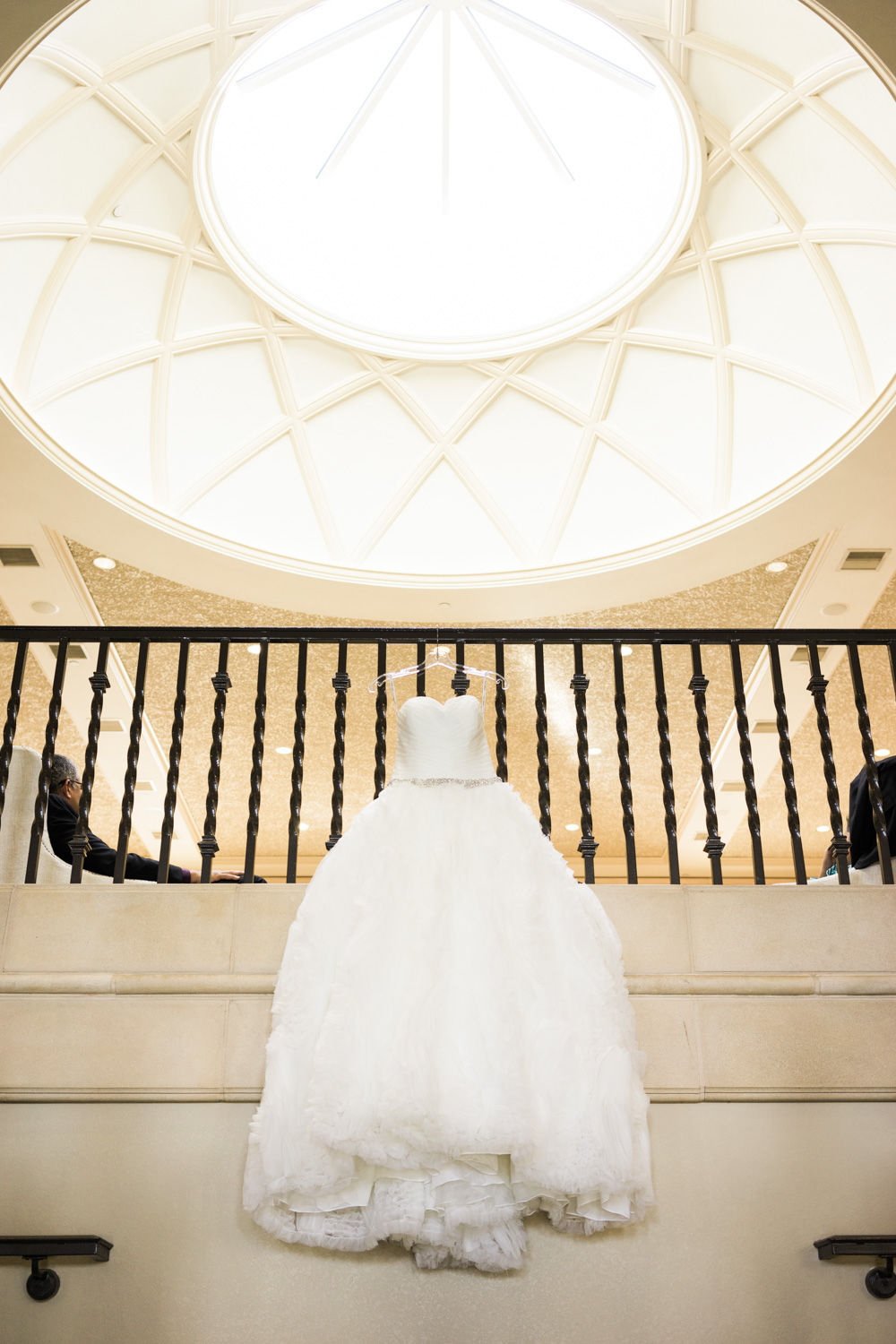 The wedding gown hanging from top of the stairs at the Ruby hill club.