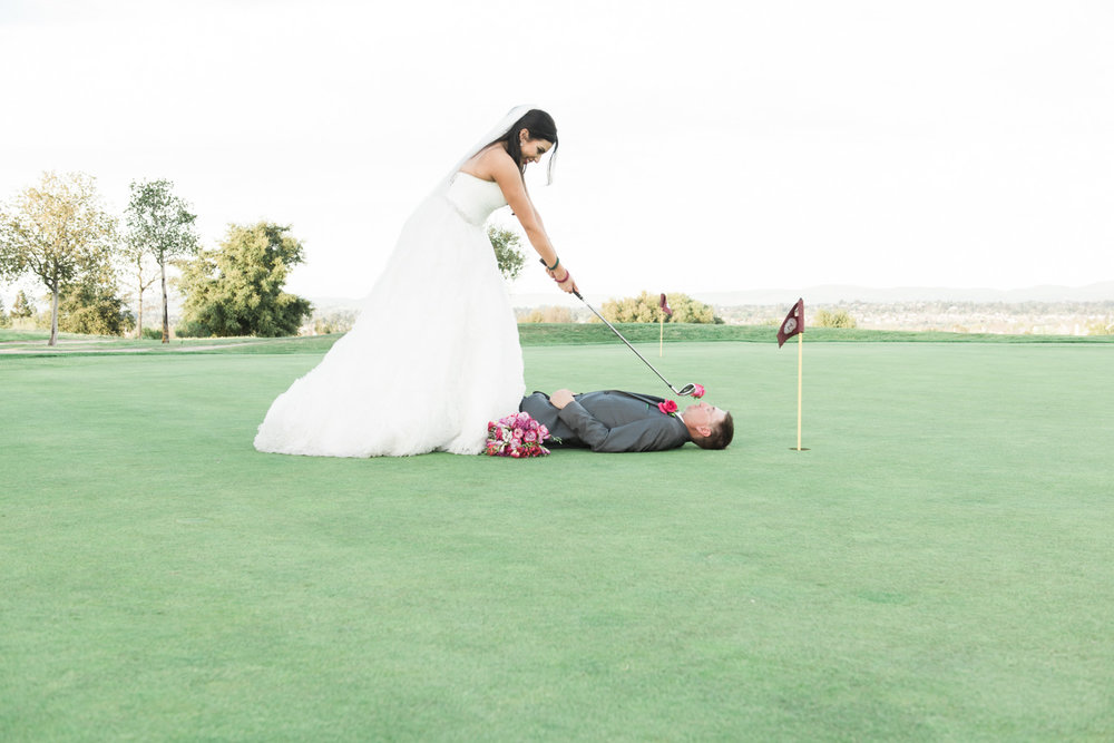 Bride taking a golf shot.