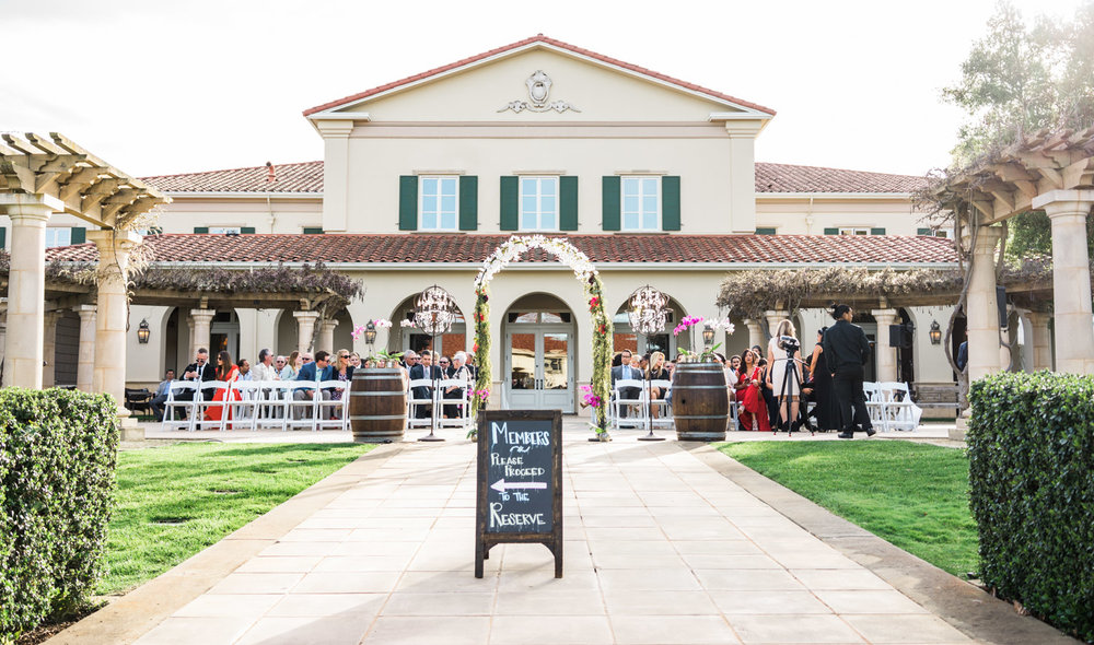 The spring wedding ceremony held outside in the open courtyard.
