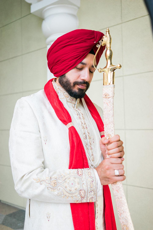 Sikh groom holding the sword
