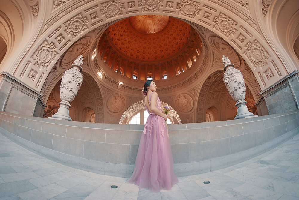 Beautiful bridal photography under the arches of SF's City Hall