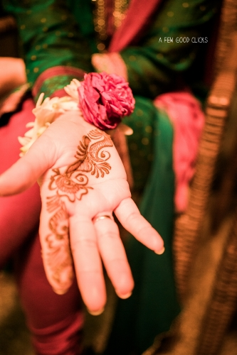 Minimalist henna tattoo on the hands of bridal party.