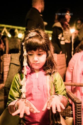 Young kid enjoying mehndi ceremony during the Indian wedding.