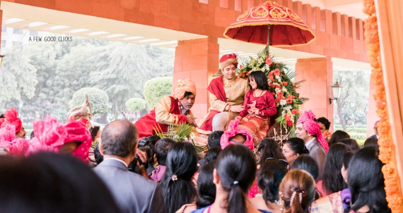 The bride's family welcomes the groom who arrived on a special horse drawn carriage.