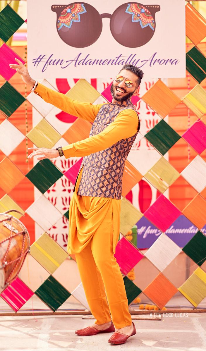 Groom dancing on the bhangra tunes.