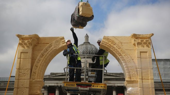 Workers place the final of seven pieces on the Triumphal Arch