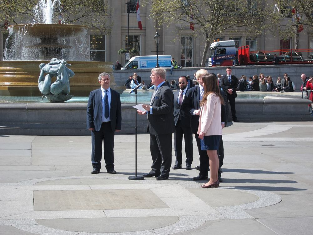 Roger Michel speaks before the unveiling of the Arch on Trafalgar Square