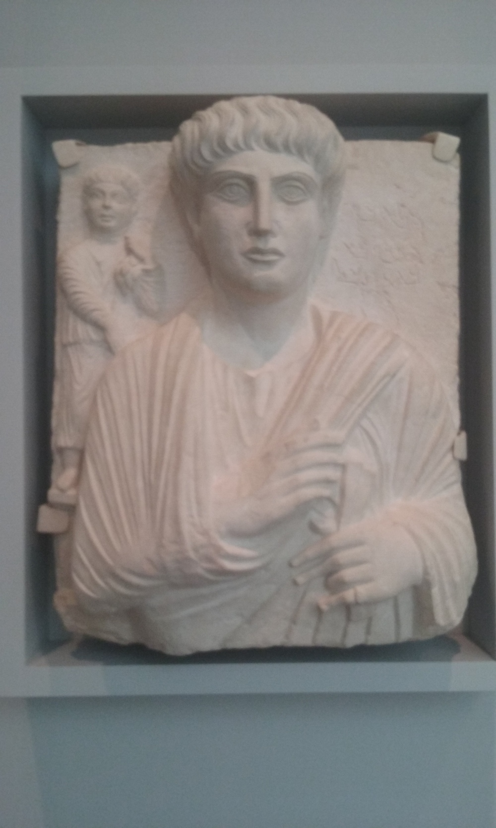 Relief of a Man and Child, wearing both Greco-Roman and Parthian style clothing