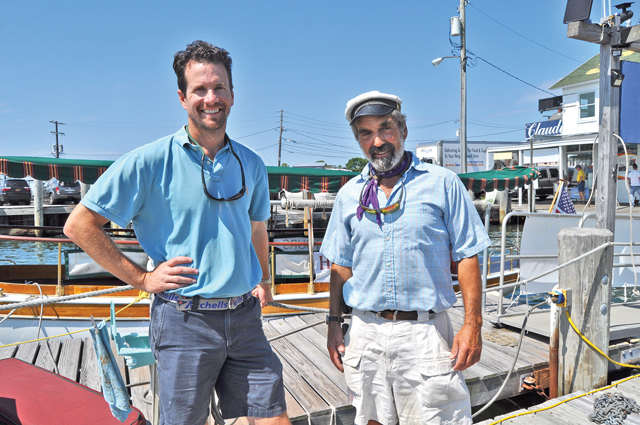 Andrew Rowsom, owner of Preston's and co-owner of Glory, and Captain David Berson standing on Preston's Dock in Greenport. (Credit: Rachel Young)