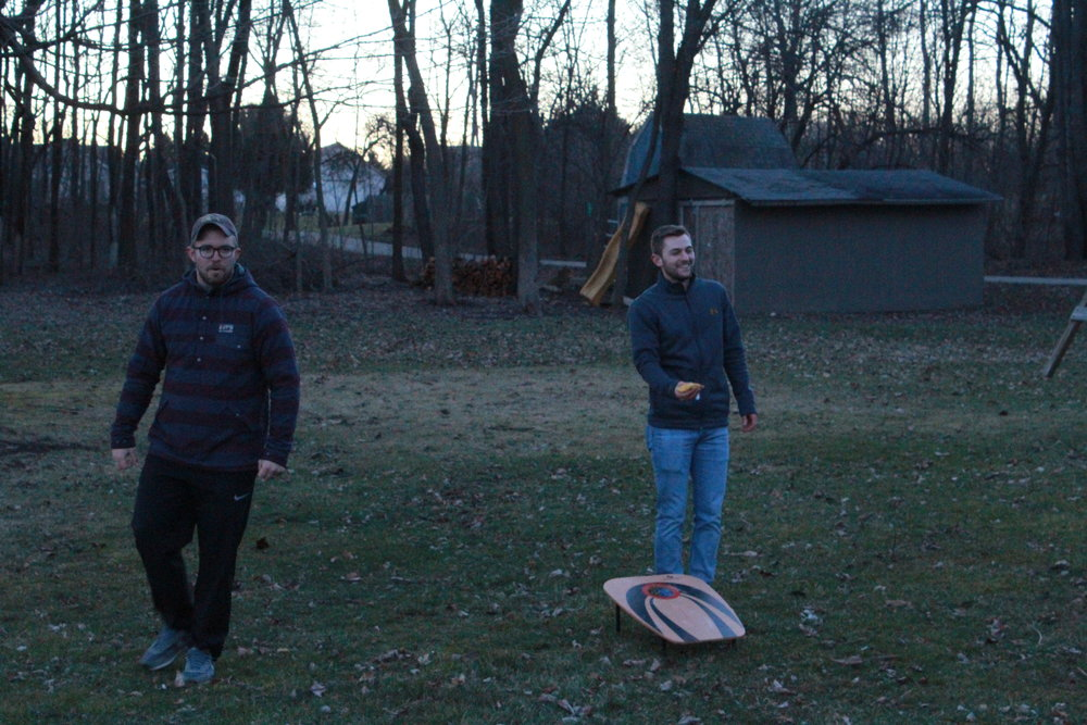 Grayson Bundick (left) and Christian Manes (right) compete in a game of bocce ball