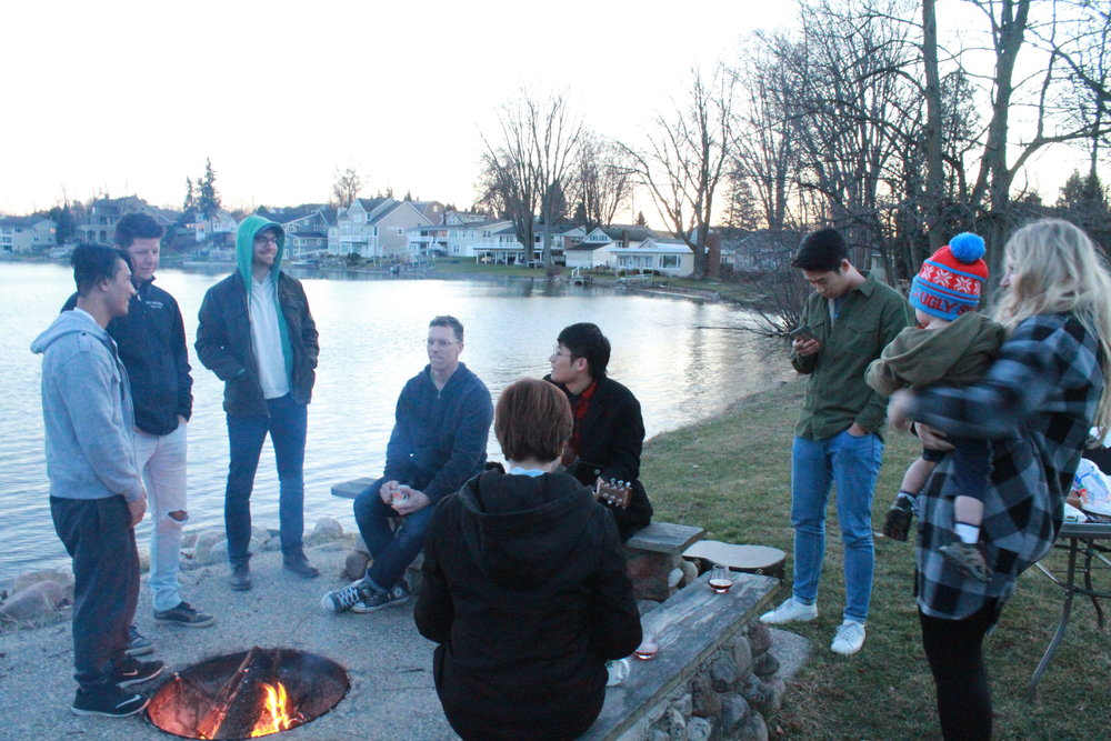 Chapel Tour team enjoy a bonfire in West Michigan