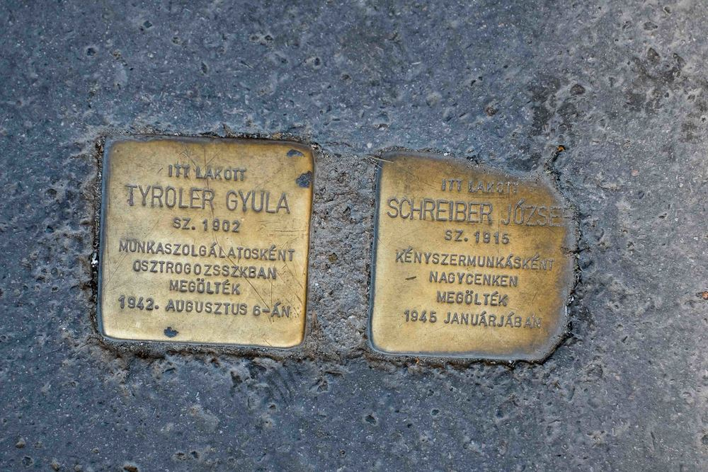 Stones of Stumbling. Plaques in the pavement in front of homes where Haulicaust victims were known to have lived. A way of remembering.