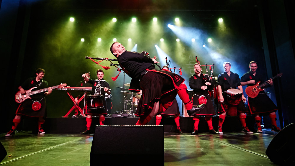 The Red Hot Chilli Pipers • a 9-piece ensemble consisting of pipers, guitarists, keyboards, & drummers