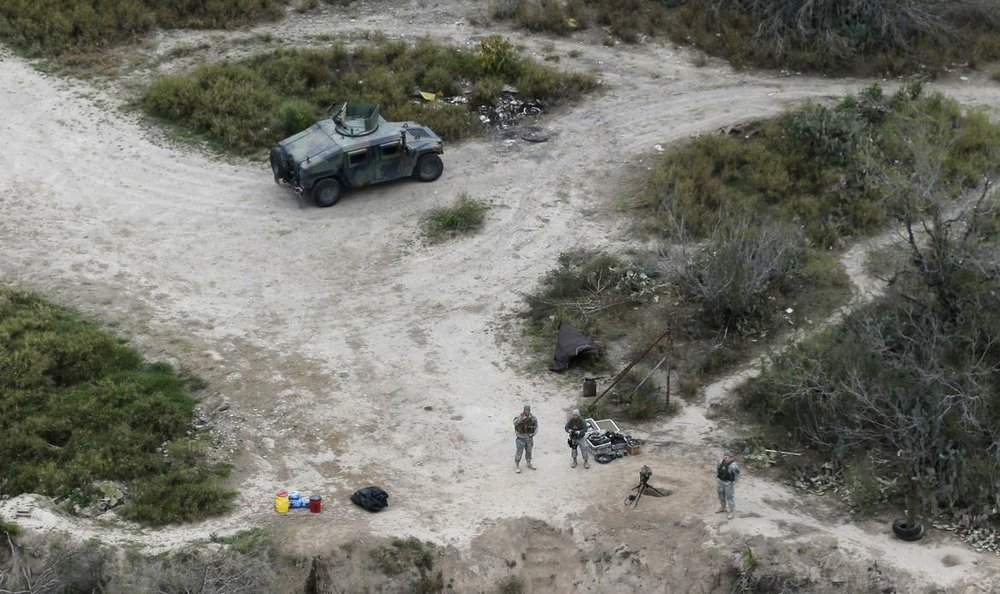 Members of the National Guard patrol along the Texas-Mexico border,Febuary. 24, 2015.
