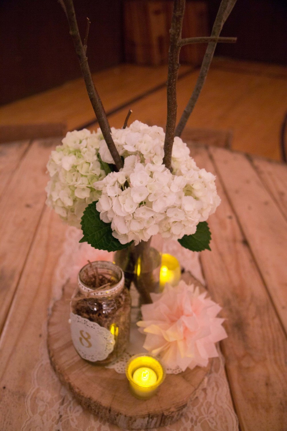 7_18-Hall_CenterPiece_Hydrangeas_WoodRounds_masonJars_1908 2.jpg