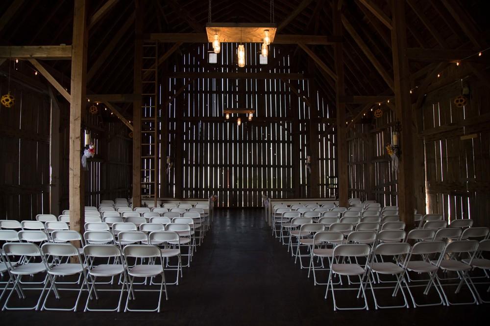6_27-barn_white_chair_Ceremony_6158 2.jpg