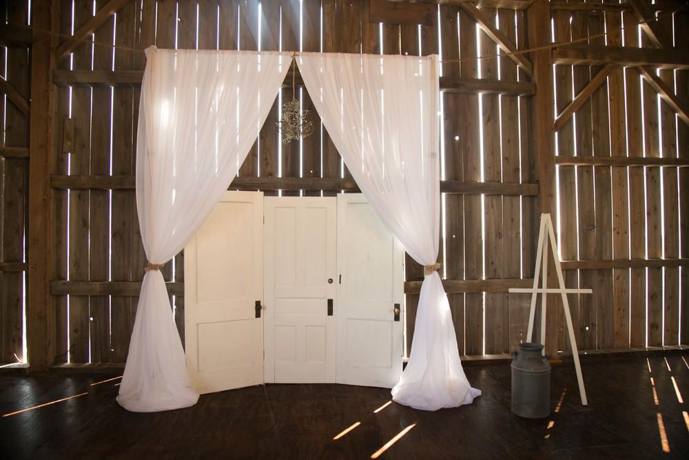 8_14-Barn_Altar_Drapery_Setup_5528 2.jpg