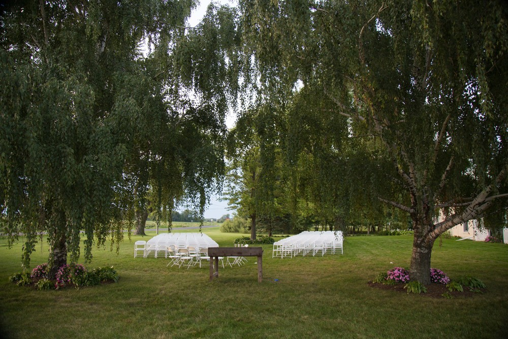 8_21-birches_ceremony_white_chairs_5885 2.jpg