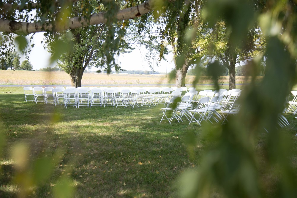 9_25-Birches_ceremony_white_chairs_8428.jpg
