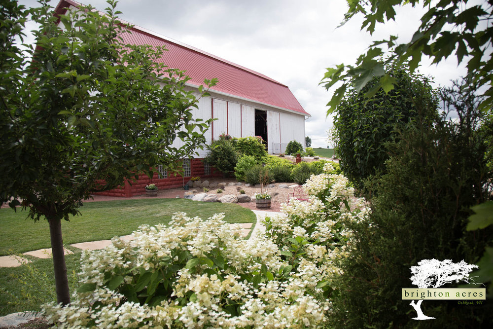 - Erected in 1915 this space, maintained in its charmingly raw form, provides an ideal setting for your wedding ceremony, dinner or dance.  Natural light casts a warm glow through the beams during your ceremony, engulfing you and your guests with joy as you share your vows.  At night the barn is filled with warm light inviting your guests to join the party, providing an intimate warmth for the courtyard.  Your choice of decor transforms The Barn into a space all your own.  A beautiful wood deck extends from the south side, adding a scenic view overlooking the rural Wisconsin countryside and maximizing your gathering space.