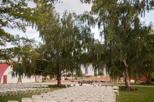 - Our largest outdoor ceremony location with a capability of seating 400 guests. Two weeping willow trees accompanied by a backdrop of the barn make for a beautiful ceremony location.