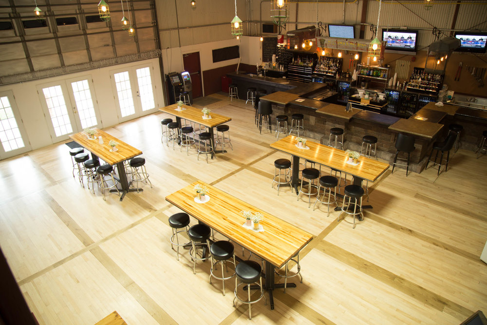 - A unique space for guest to gather and have a few drinks. The bar area has four permanent custom-made bar tables as well as unique light fixtures. The space also hosts a groom's room; an area for the groom and groomsmen to get ready.