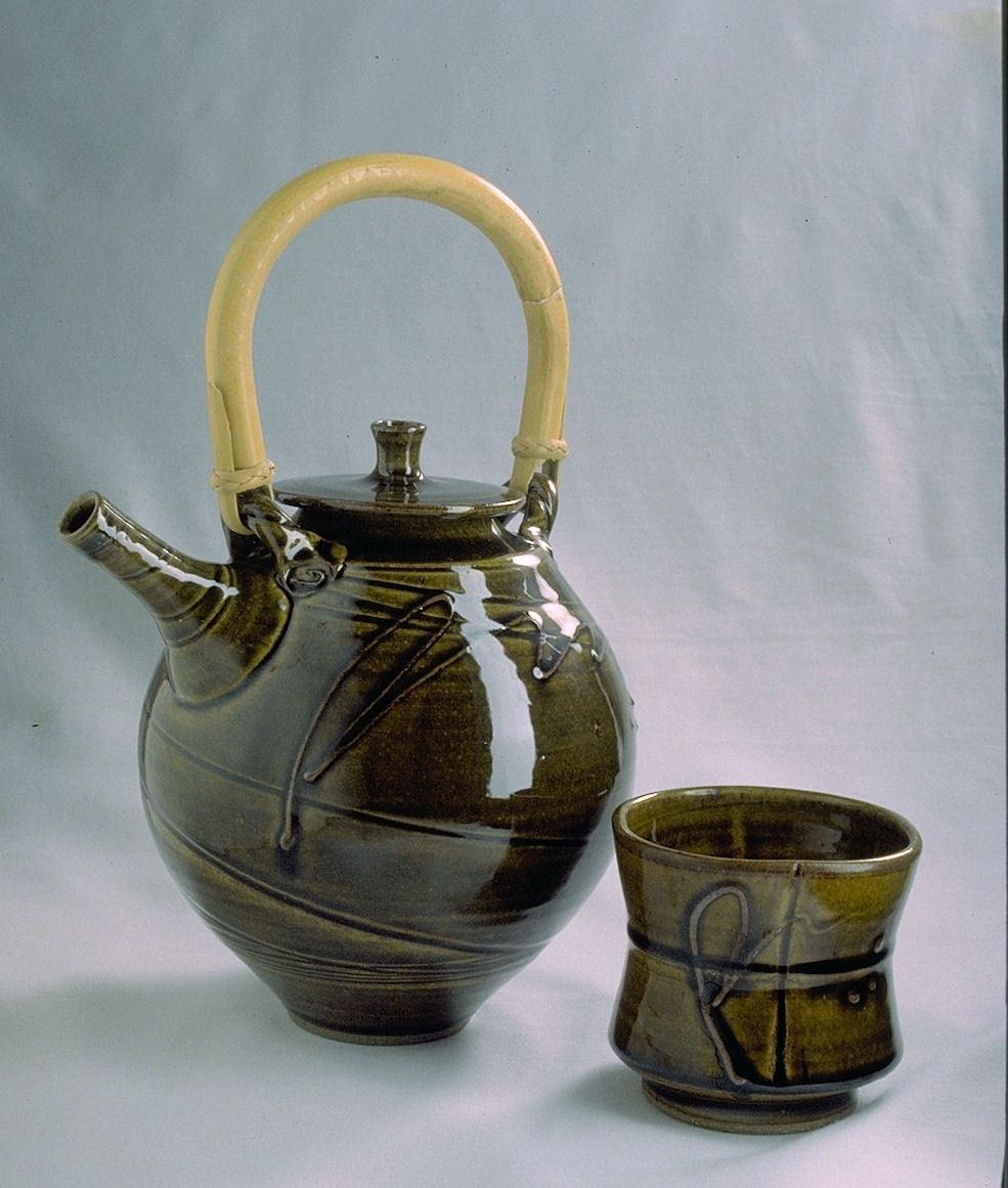 teapot in amber celadon with slip-trailed fly line loop.