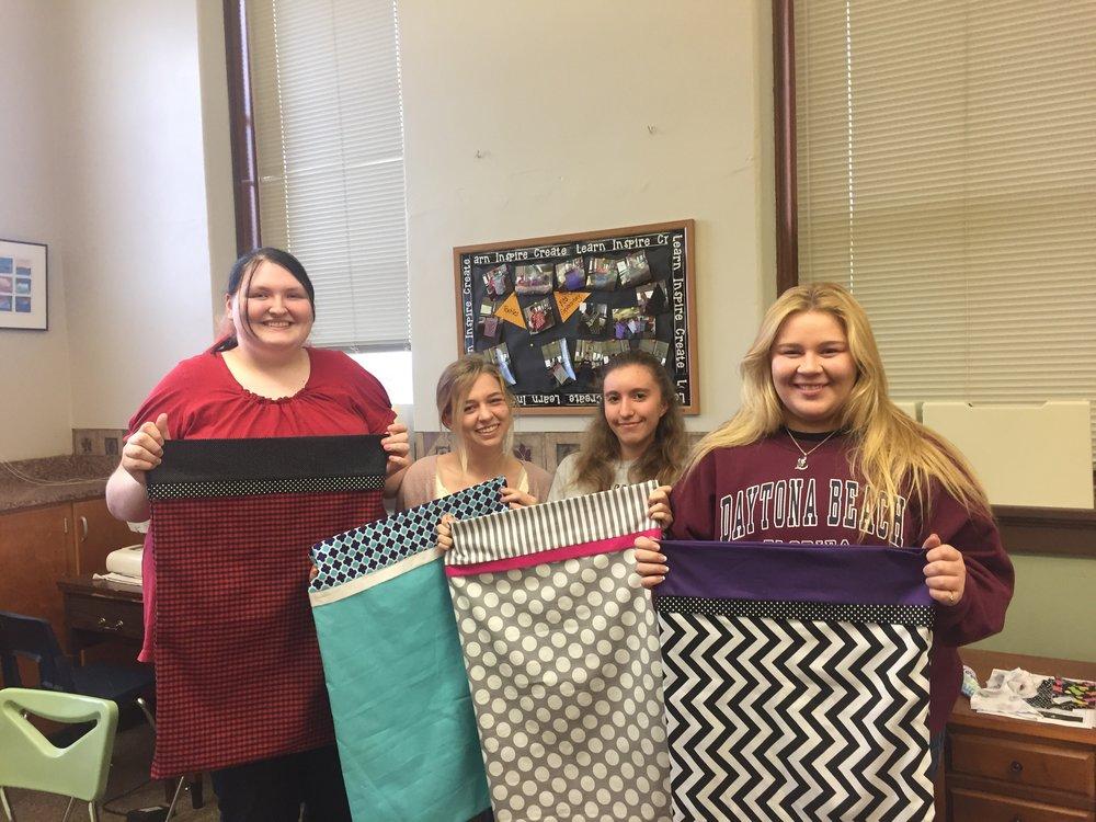Raina Hoffman, Chloé Brown, Emma Carlson, and Maya Gigaroa holding their pillow cases.