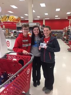 Kody Lamb, Josey Johnson, and Delaney Turner stopping at Target to buy items for Hygiene Drive.