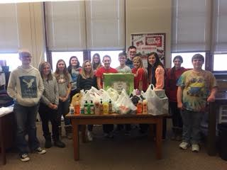 FCCLA Students standing with all the items donated to the Hygiene Drive. The students are grateful for the public's donations!