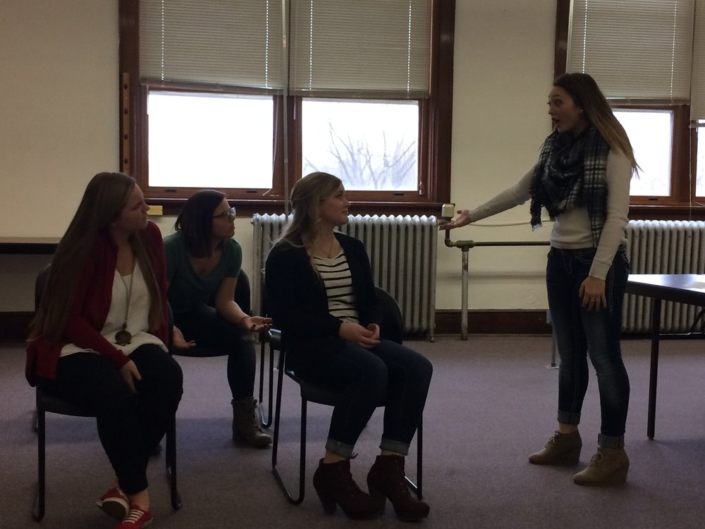 Ensemble Acting Group practicing their acting piece for Speech Contest.
