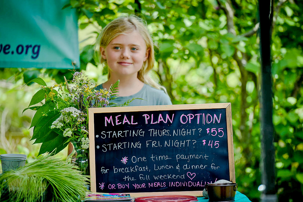 A young volunteer helps out at Krishna's Kitchen, a YogaFest staple eatery providing delicious vegetarian food that has been lovingly prepared by  Harmony Collective Ypsilanti .