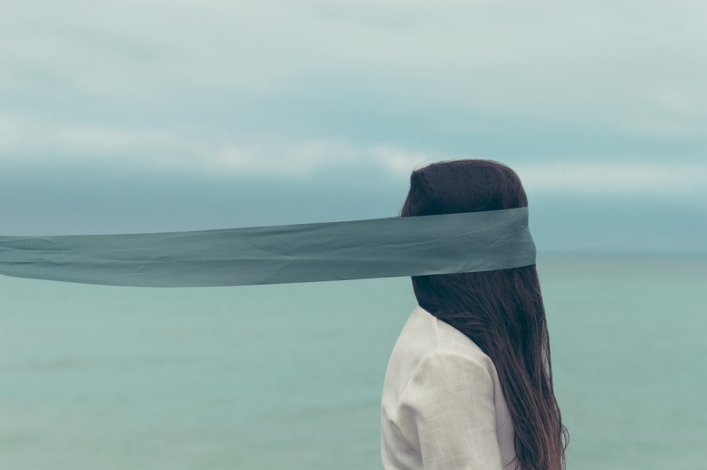 This content of this post makes me think of the Two of Swords card, where a woman is blindfolded by the sea. There's no middle ground; she must make a choice. Which sword will she choose - or will she put them both down? Image by   Oscar Keys