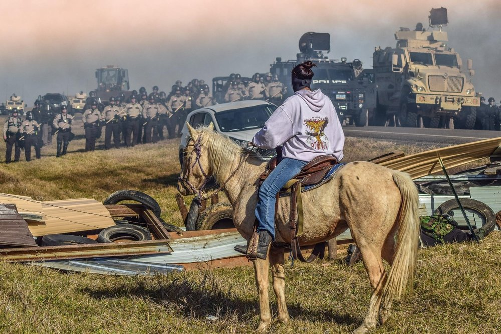 image of an unarmed activist at Standing Rock by  Ryan Vizzions