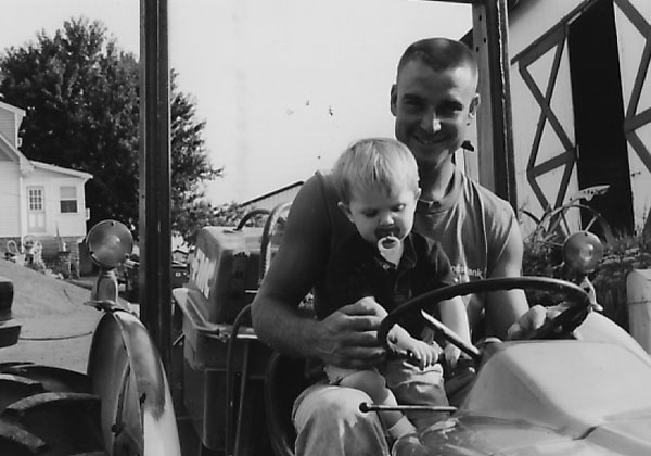Larry and Mason riding on the tractor circa 1999.