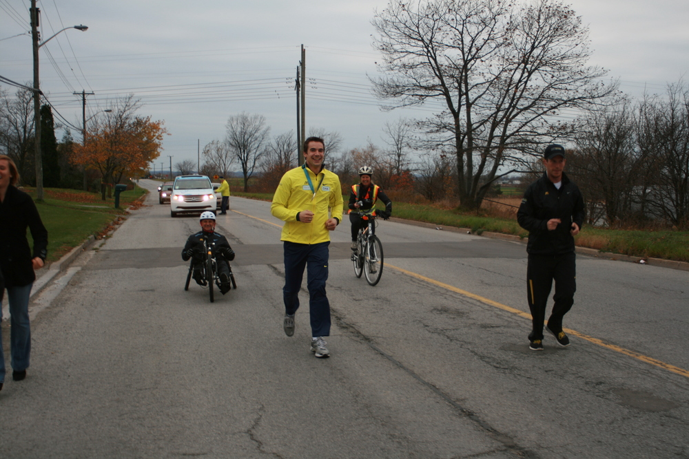 Running in the Rick Hansen 25th anniversary Man in Motion tour.