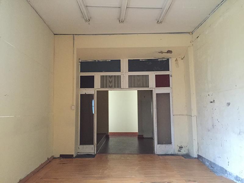 Before: Work space looking towards change room area (June)