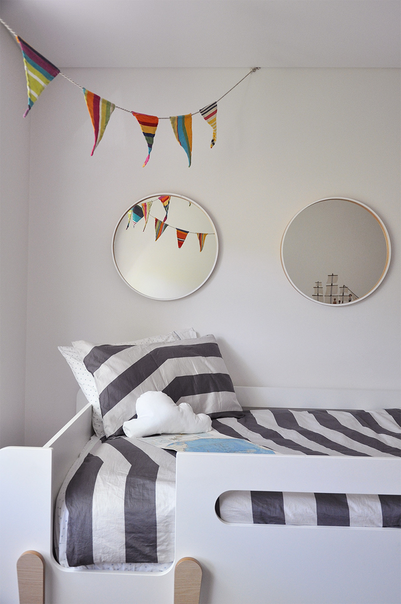 Flags and portholes over the bed