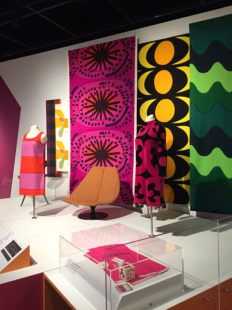 Marimekko fabric and dresses, with Gordon Andrew's 'Rondo' chair upholstered in Alexander Girard 'Checker' fabric.