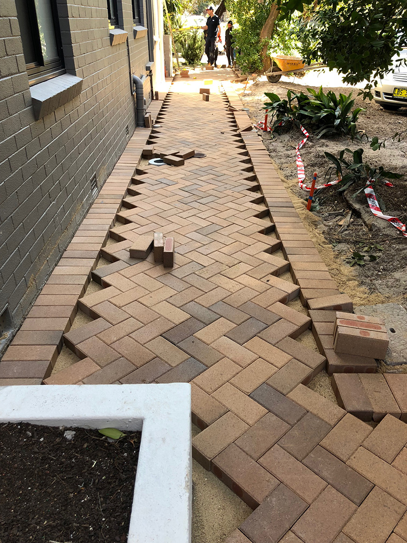 Construction Phase: brick pavers being installed