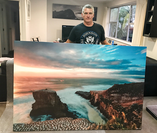 Don't let Simon Gilbert's frown put you off- go big for home, this is   Muriwai Ganets   at 2000mm wide... and Piha Storm in the background