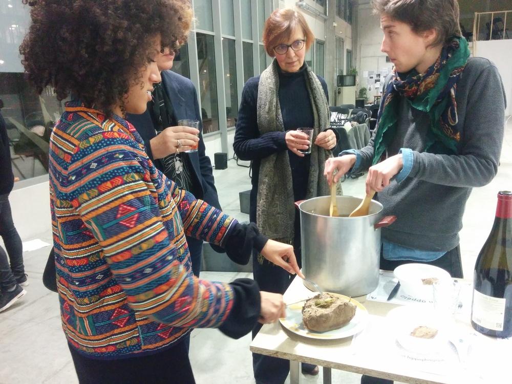 Eva Barois De Caevel serving the pot-au-feu to participants.