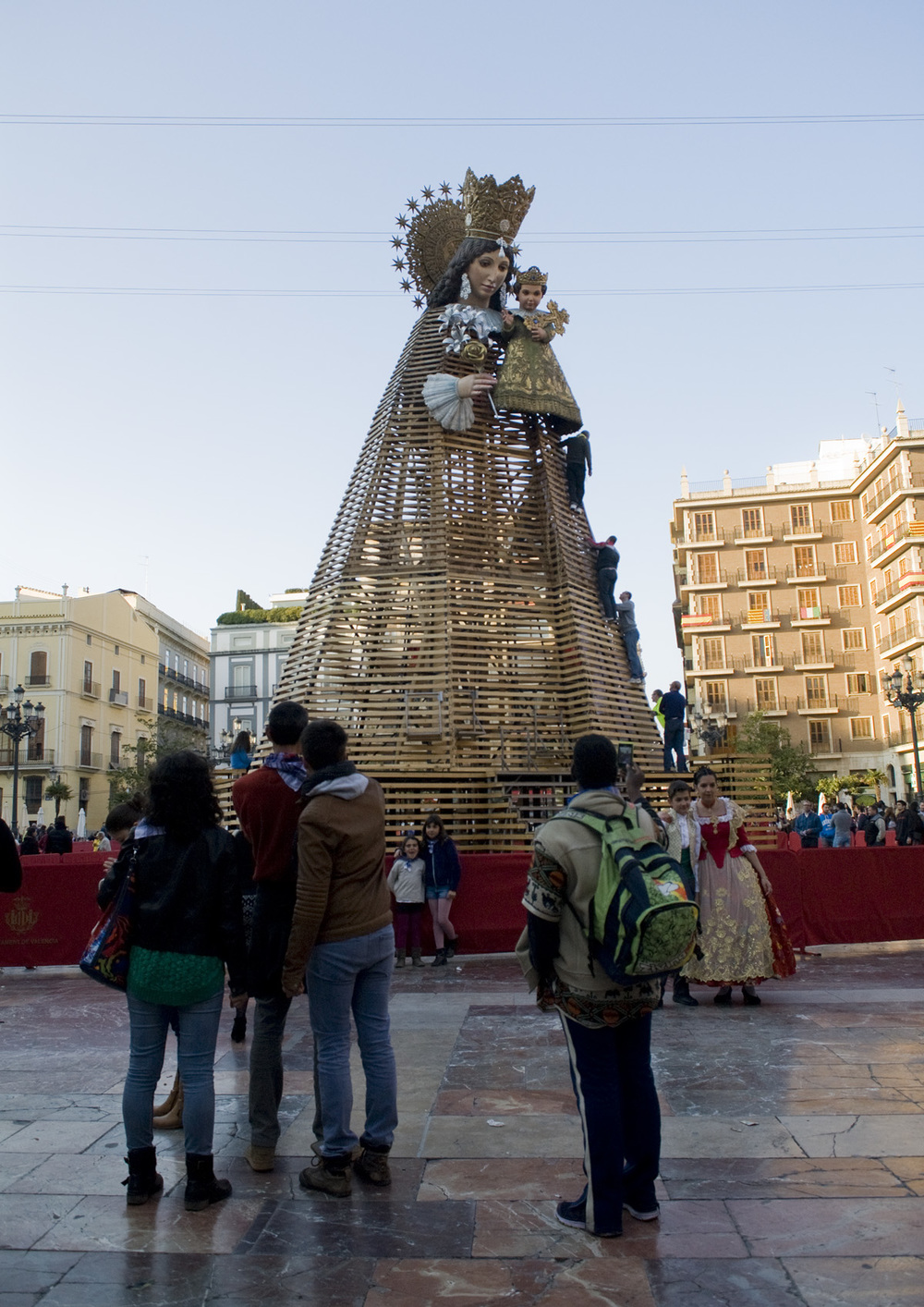 A great wooden structure depicting the Virgin Mary holding baby Jesus is located in the city's oldest square. It's a major focal point of the Fallas festivities, as for a couple of days falleras and falleros process from their neighborhoods to the square with bouquets of flowers. The flowers are placed throughout the wooden structure, creating a beautiful dress.