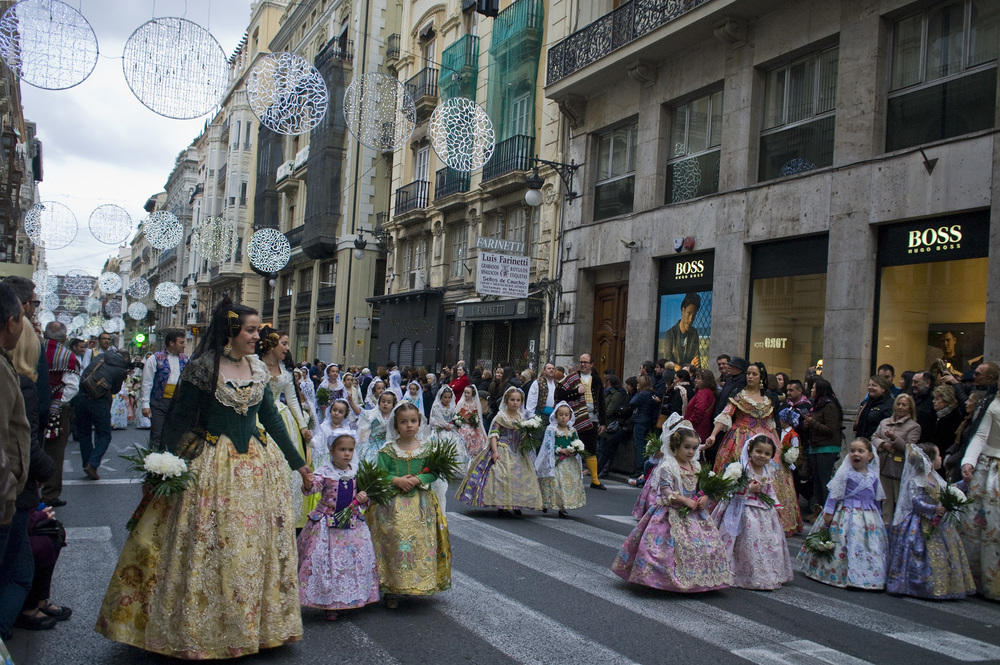 "The  Ofrenda - literally ""offering"" in English- is the formal procession the falleras and falleros make to the the Plaza de la Virgen, bringing flowers that will make up her elaborate dress."