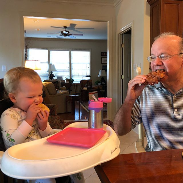 G Daddy showing Adileen how to eat her first donut. Needless to say, she loved it. #adileenkate